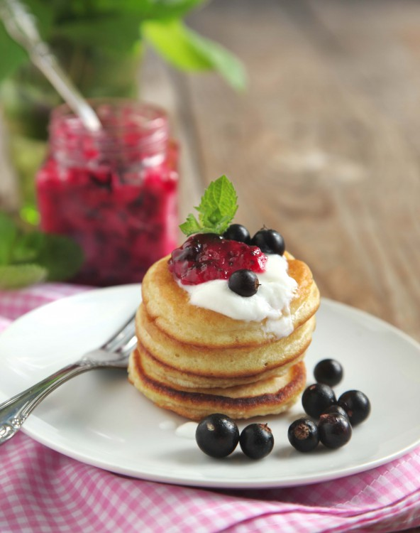 Pancake with sour cream and black currant jam